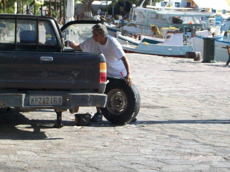 If you're going to have a puncture, a Halki harbour-side seems the perfect place!