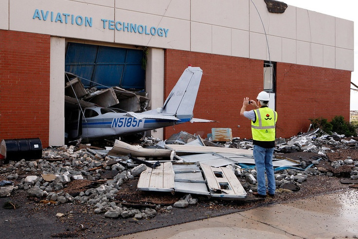 Cary Dehart photographs tornado damage at Canadian Valley Technology Centers Aviation Technology building in El Reno, Oklahoma June 1, 2013.