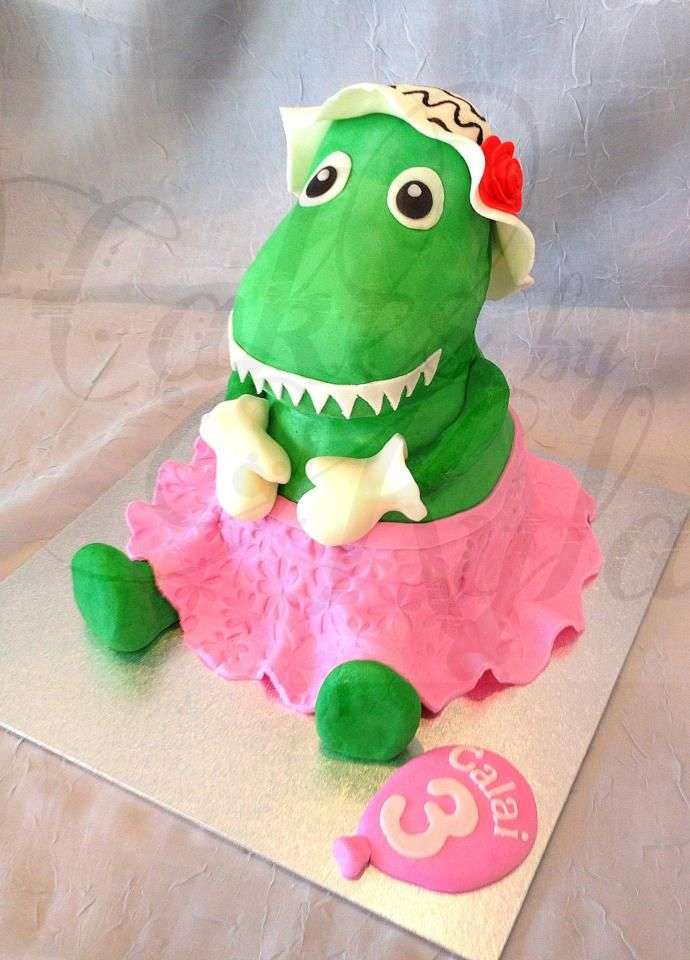 Hand sculpted 3D 'Dorothy the Dinosaur' chocolate mud cake with chocolate ganache and hand crafted fondant details.