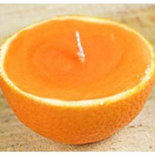 Vela feita com casca de laranja