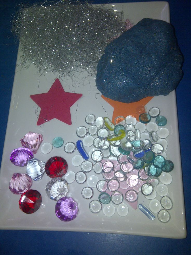 galaxy playdough (just add glitter and food colouring) accompanied by some fun loose parts
