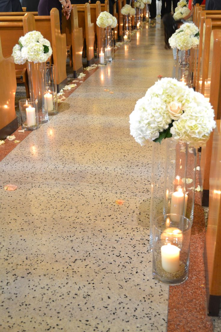 #wedding #church #ceremony #candles and flowers along #aisle #decor #hydrangeas #candles, www.lepapillonevents.com