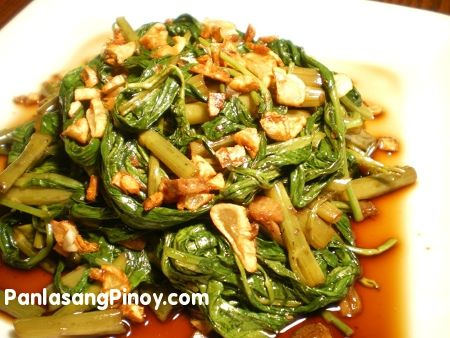 Adobong Kangkong is a simple vegetable dish that is considered a staple in many Filipino homes. Water Spinach which is locally known as Kangkong is the main ingredient for this healthy Adobong Kangkong Recipe.  There are several varieties of Kangkong. In the Philippines, the most common variety is the wide-leaf ones; these are usually seen floati