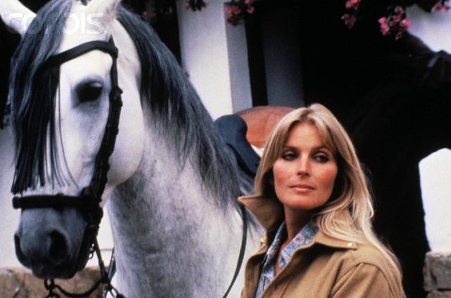 Actress Bo Derek Posing with White Horse
