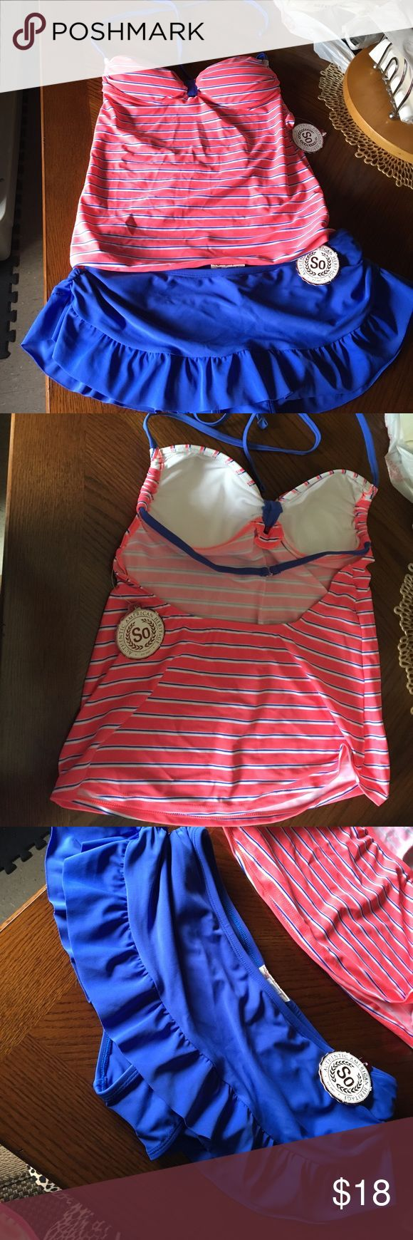Tankini swim set NWT Brand new tankini swimsuit set. New with tags. Is a size large in juniors but fits like a regular size medium for a woman or young adult. The bottoms are like a skirt with a bikini interior. Swim Bikinis