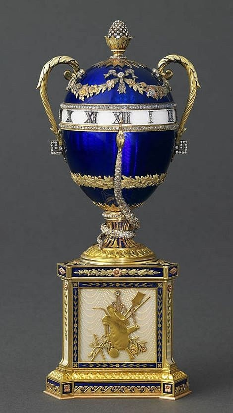 """The 'Blue Serpent Clock' Faberge Egg, crafted in 1887 for Tsar Alexander III.  It is the first of the """"Imperial"""" Eggs to feature a working clock.  This egg and one other (the 'First Hen' Egg) are the only  known surviving Imperial eggs from the 1880's.   This egg is currently owned by Prince Albert II of Monaco."""