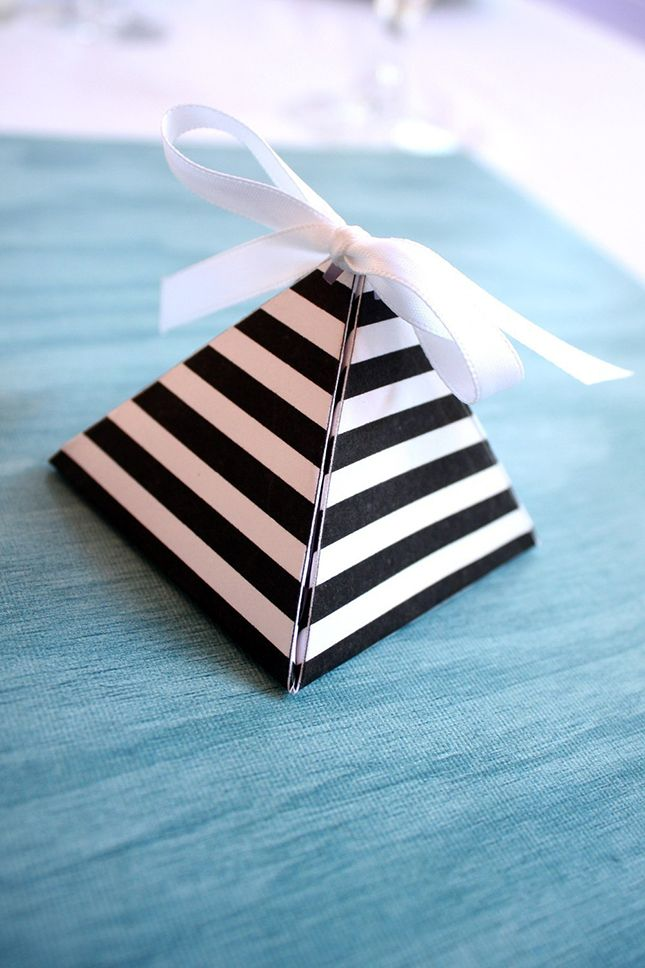 Put your favors in these little pyramid boxes.