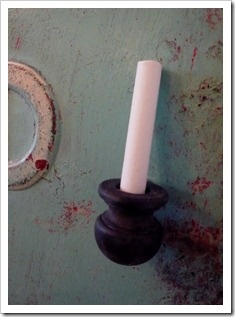 Another good idea for a chalk holder.  A finial or candle cup from the craft store with a magnet on it.