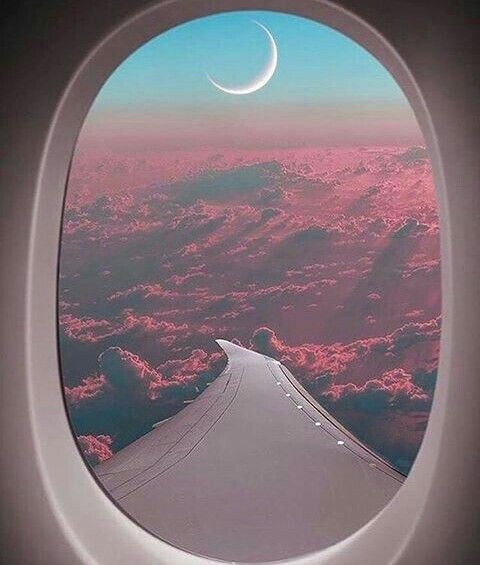 The airplane and the sky and the moon..perfect combination