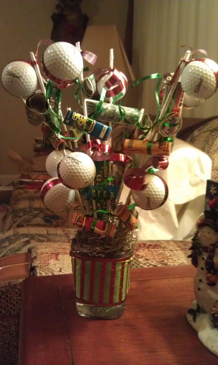 A tree with golf balls and lottery tickets