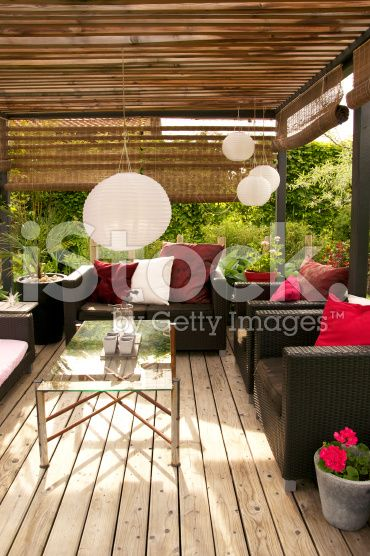 Patio with a pergola and modern outdoor furniture royalty-free stock photo