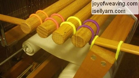 DIY tension device for beaming-on a warp. I have got to try this on my next warp...