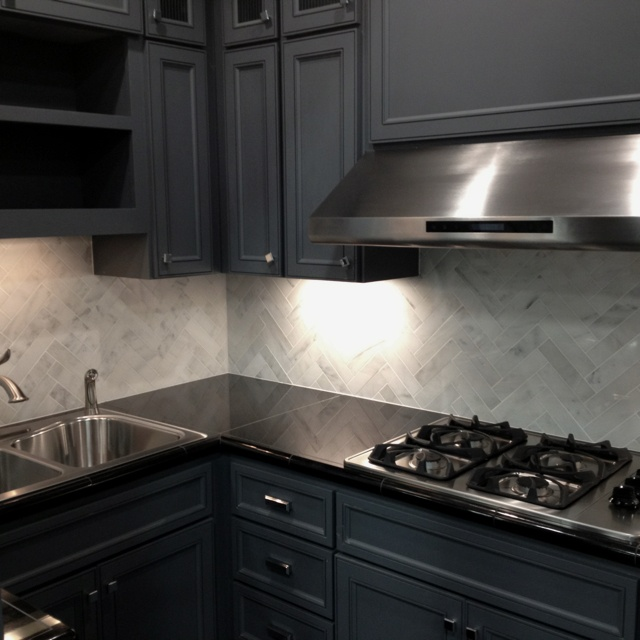 Modernized kitchen marble backsplash kitchens for Gray kitchen cabinets with black counter