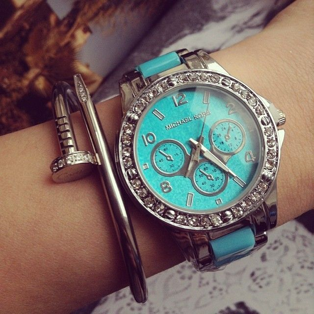Michael Kors Watches 2014....I like the watch but I like the nail bracelet more lol
