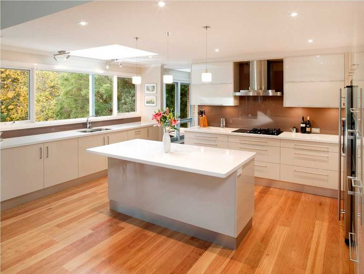 Open Kitchen Design Ideas with white cabinet and wooden floor