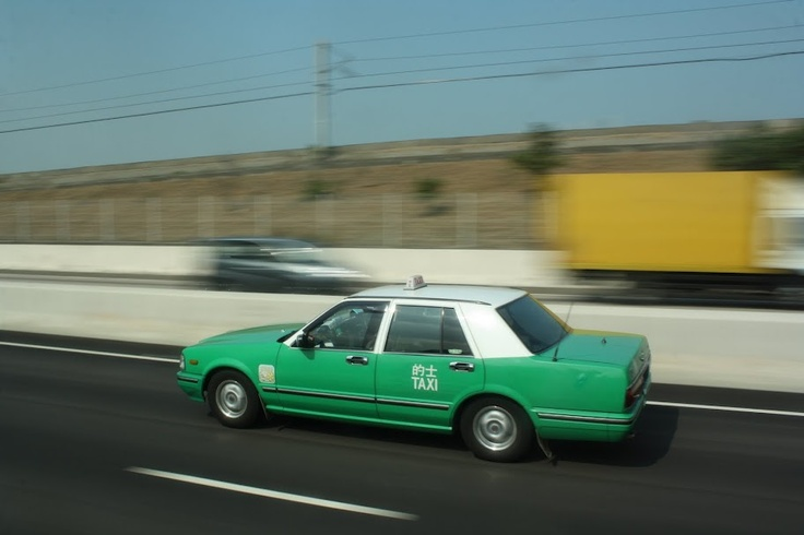 A Hong Kong taxi.  Same car from memory and they come in either green or red.
