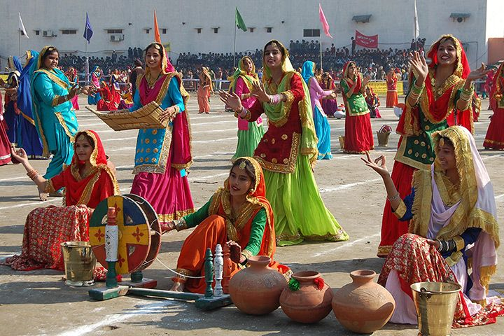 Indian youths perform a Punjabi traditional folk dance, the Giddha, in Amrit