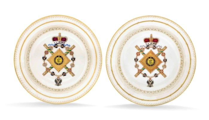 TWO PORCELAIN PLATES FROM THE SERVICE OF FIELD MARSHAL PRINCE BARYATINSKY BY THE IMPERIAL PORCELAIN FACTORY, ST PETERSBURG, PERIOD OF ALEXANDER II (1855-1881). Each circular, the centre painted with the badge of the Order of St George and the chain of the Order of St Andrew surmounted by the Imperial crown, with crossed Field Marshal's batons, the border with gilt ciselé decoration.