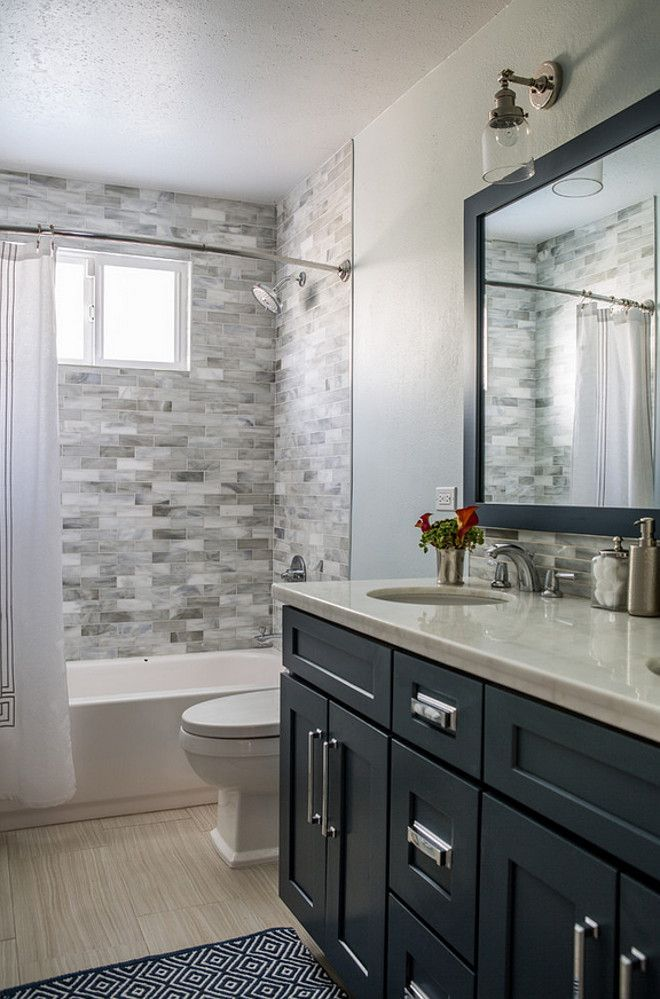 Transitional Bathroom Design With Navy Blue Cabinet With Polished Nickel  Hardware.