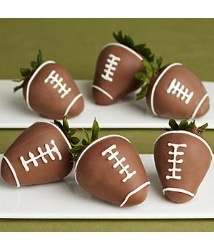 Football Chocolate covered strawberries.  Yumm.  Great Idea for tailgating