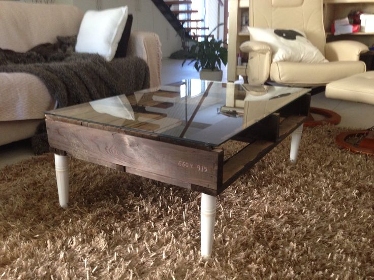 Coffee table I made out of recycled wooden pallet. Design etched on by my daughter using a wood burning instrument.