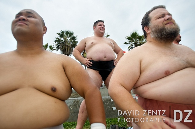 Sumo wrestlers in the heavyweight division, from left Americus  Abesamis, Dan Kalbfleisch and Kelly Gneiting, wait for their turn to  compete in the US Sumo National Championships, which were held on the  Venice Beach basketball courts in Venice, Calif., on Saturday, June  13, 2009.Life Size, Curves Appeal, June, Venice Beach, Sumo Wrestlers, Heavyweight Division, Big Guys, Basketball Court, National Championship