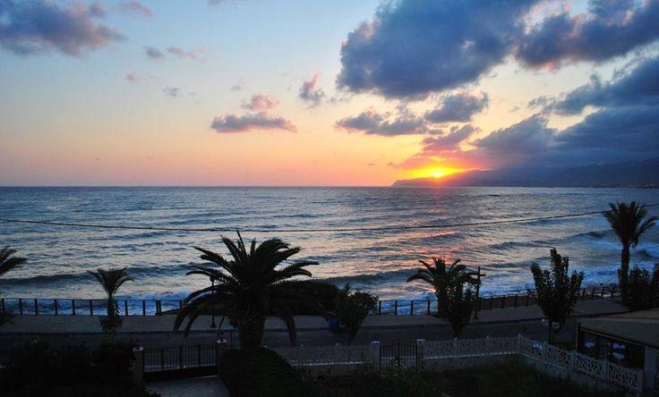 Crete. Sunrise over the wonderful bay near Malia - Stalis.
