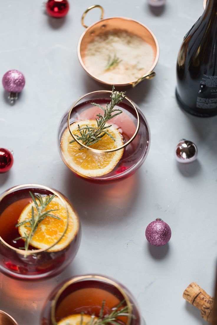 Can't wait to try Cranberry Orange Champagne Mimosa with Candied Rosemary cocktail for brunch! Just as simple as traditional homemade mimosa recipes but with cranberry and candied rosemary.