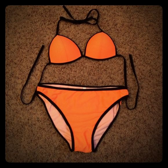 Orange triangle Bikini swim Brand new! I bought online but doesn't fit my top! So cute and perfect for those sunny days.  This is a dupe but looks very similar! N/A Swim Bikinis