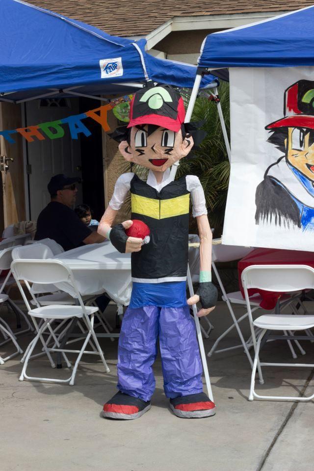 """Life size paper mache """"Ash"""" from Pokemon piñata"""