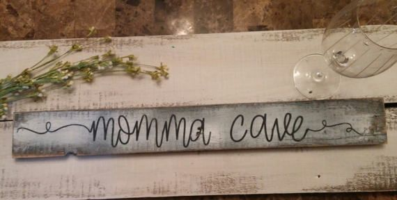 Momma Cave rustic wood sign! Perfect for your kitchen, she shed, bedroom, bathroom or any place you take shelter from it all! Makes a perfect MOM gift! White washed with hand painted black lettering on reclaimed vintage wood. Sit or hang this sign. Comes with saw tooth hanger.  measures approx: 24 X 3  Our signs are made with reclaimed wood. We distress our wood by hand and hand paint our signs. No two will be exactly the same.  Contact us for custom work.