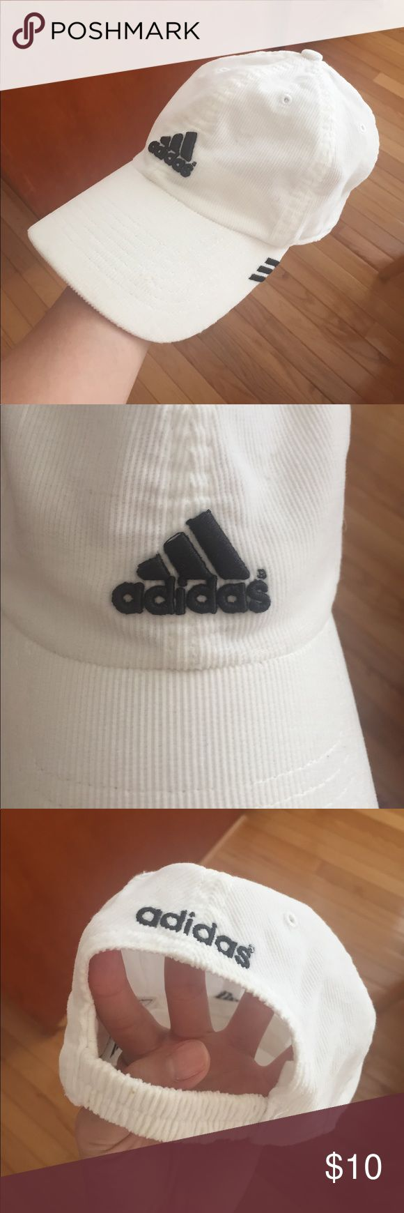 Black and White Adidas Baseball Cap So chic and cool for everyday wear. Black and white style in a light fabric makes it easy to wear in the summer months as well. Slight staining on the cap line - see pictured (although could probably come out with a good wash). Elastic band in the back allows for comfortable fit. adidas Accessories Hats