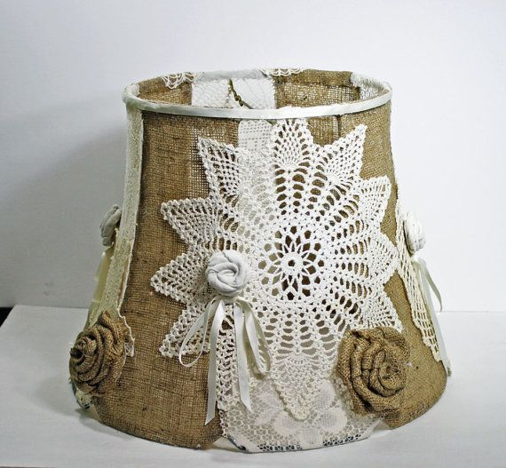 handmade lampshade, burlap and crochet lampshade, large upcycled lampshade, shabby cottage chic lampshade, ooak    made from vintage doilies and burlap.  beautiful mixture of shabby and rough. first i stripped this large old lamp shade down to its frame. then i covered every other panel in burlap and used it as the base  to add vintage crocheted doilies to the open  panels. lastly i hand rolled the tattered roses from burlap and vintage fabrics. even the little satin bows are tied with…