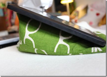 Lap desk wedge. Would work for iPad and would also be cool to size large enough to hold a book. Could also prop a firm board on top to create a lap desk.