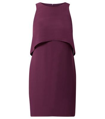 This purple layered shift dress is a great alternative to the classic little black dress on an evening out. Add black glitter heeled ankle boots for the autumn season.- Layered design- Zip back fastening- Round neck- Sleeveless design- Loose chiffon fabric- Dress length: 35