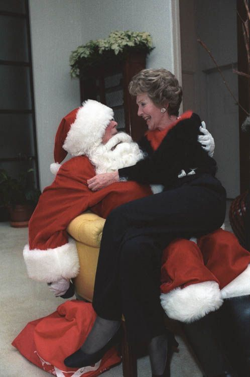 …and Nancy Reagan sits on his lap. | The 17 Most Excellent Presidential Christmastime Photos