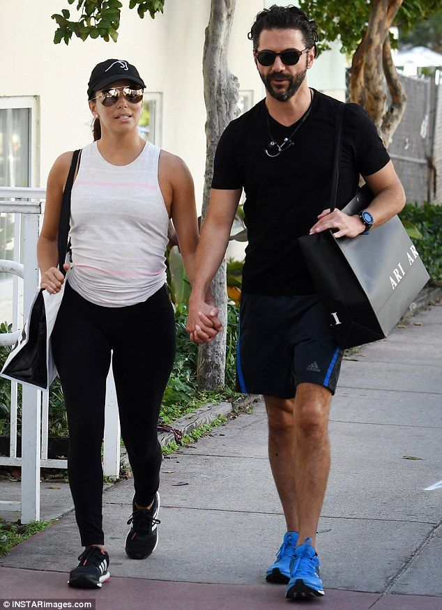 A perfect pair: Eva and the Mexican media mogul were married last year in Mexico City. Above you can see the pair holding hands while in Miami, Florida January 18