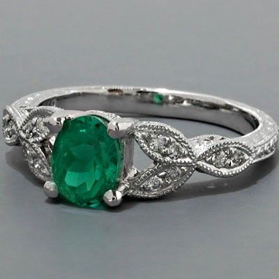 A White Gold Diamond and Emerald Ring .