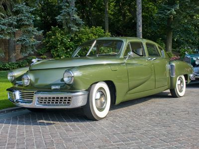 The 1948 Tucker Torpedo. First car to feature standard seatbelts, safety glass, and the only car built (to my knowlege) with a headlight that moved left to right with the wheels. Very few still exist.