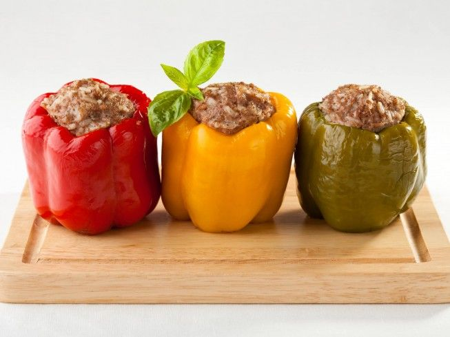A recipe for Stuffed Bell Peppers made with bacon, ground beef, salt and pepper, onion, poultry seasoning, rice, bell peppers, egg