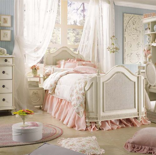 lovely light blue walls, white cane bed, light pink dust ruffle, cream floral bedding, painted dresser, very shabby chic