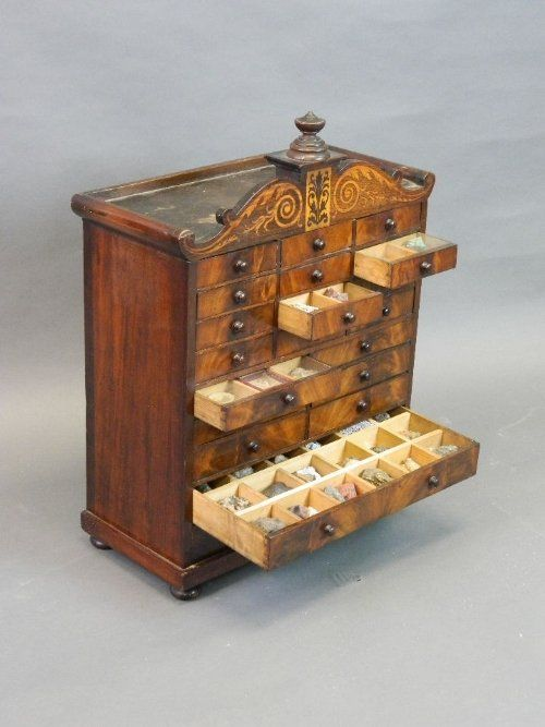 A Regency inlaid figured mahogany collector's cabinet with 20 drawers full of fossils, mineral specimens etc, 18¼'' x 8½'', 24½'' high.