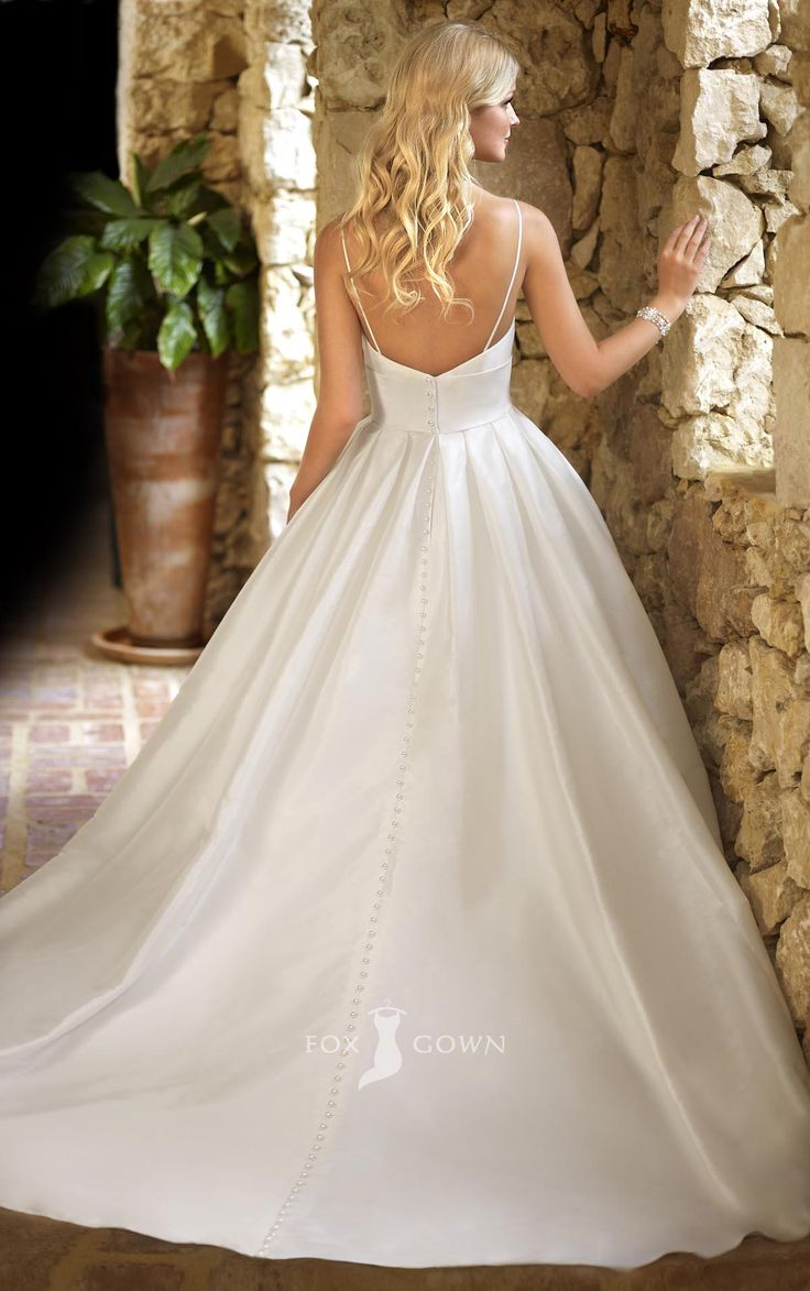 Not exactly this one but i like the style and the low for Spaghetti strap wedding dress with pockets