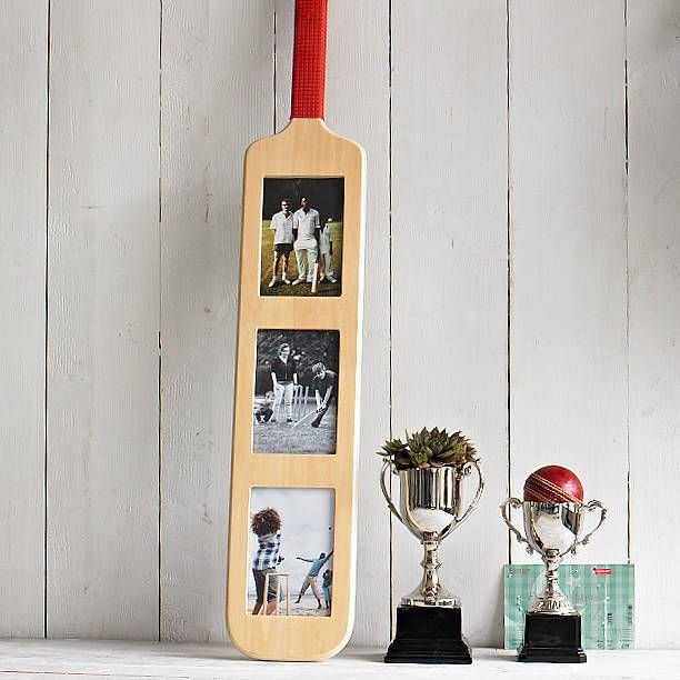 AS FEATURED IN THE METROWhat a fabulous gift for all cricket fans! Perfect for the aspiring cricketer in your life or for a man of the match award. The cricket bat frame holds three 15x10cm (6x4inch) photographs and can be hung vertically or horizontally. Includes wall-fixings. Designed in Britain. Wicket and ball not included.WoodL94cm x W14cm x H1.5cm, approx 730gms