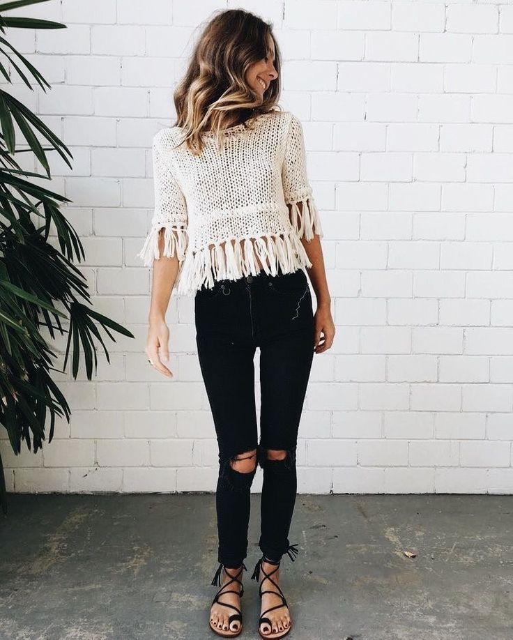 Cute off white fringed top with distressed black denim jeans.