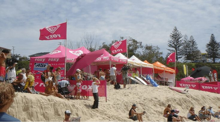 Pop up marquees with custom flags in a sporting event.