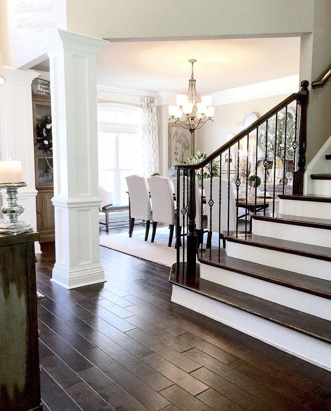 Gorgeous staircase, hardwood floors, and color scheme.