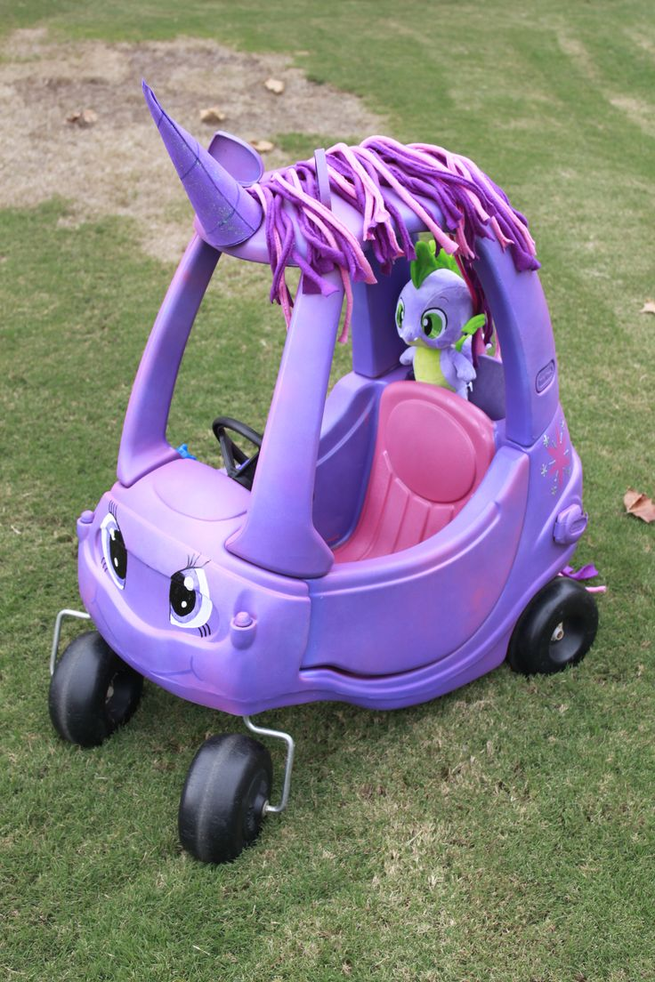 The Twilight Sparkle cozy coupe I repainted for Elaina.  I'm so happy with the way it turned out.  We had a stuffed Spike from Build a Bear, he really completes the look.