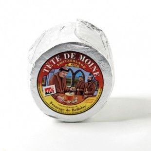 Tete De Moine Literally meaning Monks Head, this fruity cheese is traditionally eaten by shaving thin curls from it with a Girolle. Tête de Moine is from the Jura region in North West Switzerland,.Tete de Moine was initially produced more than eight centuries ago by the monks of the abbey of Bellelay, located in the community of Saicourt, district of Moutier.