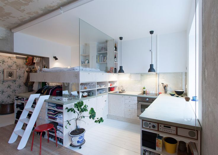 Renovated Stockholm apartment with crumbling brick and peeling plaster walls left exposed.